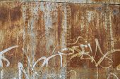 old abandoned train station, rusty iron walls, graffiti