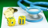 stock photo of prescription pad  - A doctors stethoscope placed on a doctors prescription pad - JPG