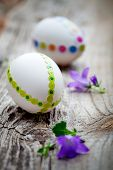 White easter eggs decorated with colorful stickers