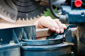 Man working with circular saw, selective focus