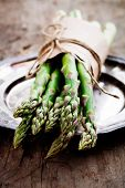 Bunch of fresh asparagus on wooden table