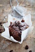 Fresh homemade chocolate muffins with powder sugar
