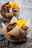 Fresh homemade cupcakes with orange and chocolate