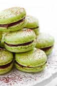 French macaroons in green with cocoa powder