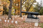 DAYTON, OHIO-OCTOBER 29, 2014:Woodland Cemetery pays tribute to Mont. Countys Revolutionary Soldiers. A cannon, erected by the Old Guard in 1901, is by the Soldiers Area, Dayton, Ohio, Oct. 29, 2014.