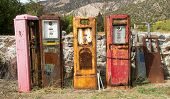 Collection of old rusting gas pumps found in an antique store in New Mexico
