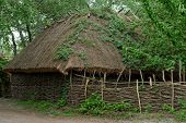 Farmer's barn under the thatch roof in open air museum Kiev Ukraine