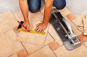 stock photo of ceramic tile  - Installing ceramic floor tiles  - JPG