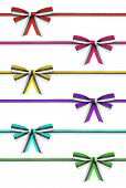Collection Of Colorful Ribbons And Bows Rep On An Isolated White Background