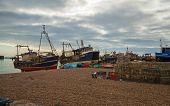 HASTINGS, UK - SEPTEMBER 27, 2014: Fish man boats