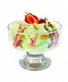 Ice cream strawberry-pistachio in glass goblet