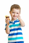 kid boy eating ice cream and showing okay sign