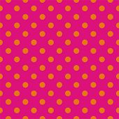 Seamless vector pattern or texture with neon orange polka dots on pink background