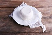 Cottage cheese on gauze on plate on wooden background