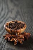 Anise Stars And Cloves On Oak Table