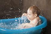 Happy Baby Splashing In Blue Little Bath Indoo