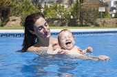 Mom And Baby In Pool Laughing