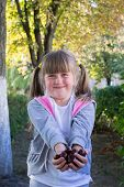 Little Girl With Chestnuts