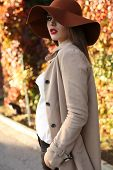 Beautiful Ladylike Woman Wearing Elegant Clothes Posing In Park