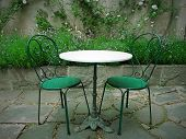 Chairs And Table In A Magic Summer Garden