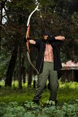pic of longbow  - Beard Man With A Bow And Arrows In The Woods - JPG