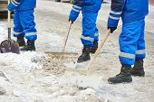 stock photo of snow shovel  - municipal urban servicing workers shoveling snow during winter road cleaning  - JPG