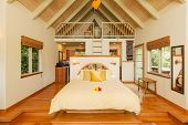 Romantic Cozy Bedroom with Hardwood Floors. Home Interior Design