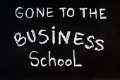 Gone To The Business School Message Written With White Chalk On Blackboard