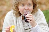Young Woman Drinking Hot Mulled Wine.