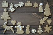 Decorated Ginger Breads On Wood