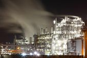 Petrochemical Oil And Gas Refinery Plant In Night