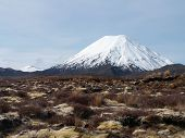 stock photo of conic  - A snowy conical mountain on the Tongariro Crossing New Zealand.