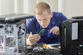 image of ram  - Young blonde IT specialist installing ram memory - JPG