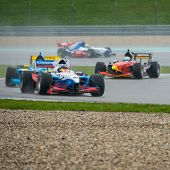 ASSEN, NETHERLANDS - OCTOBER 19, 2014: Formula FA1 cars druing the warm up lap of the final wet race of the Acceleration 2014 tour
