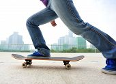 young woman skateboarder skateboarding at  modern city