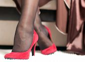 Female Legs In Red Shoes
