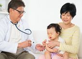 Family doctor vaccines  or injection to baby girl. Pediatrician and patient.