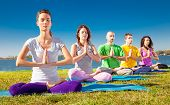 stock photo of concentration  - Group of young people have meditation on yoga class - JPG