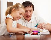 stock photo of molding clay  - Family molded from clay toys - JPG