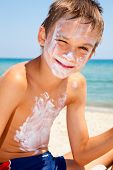 image of sunburn  - Child applied too much of sunblock cream - JPG