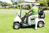 picture of buggy  - Happy golfing friends setting out on buggy at golf course - JPG