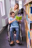 picture of classmates  - Smiling disabled student with classmate in library at the university - JPG