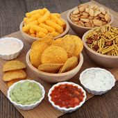 foto of crisps  - Crisp and dip party food selection in porcelain and wooden  bowls - JPG