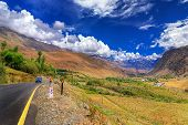 stock photo of jammu kashmir  - Road and Rocky mountains with blue sky with clouds in background of Leh Ladakh Jammu and Kashmir India - JPG