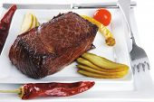 image of veal meat  - grilled meat chunk with vegetables on white plate - JPG