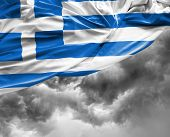picture of greek  - Greek waving flag on a bad day - JPG