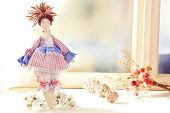 picture of baby doll  - Handmade doll near window close - JPG