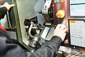 image of manufacturing  - drilling hole or boring detail on metal cutting machine tool at manufacturing factory - JPG