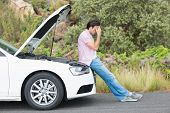 stock photo of nervous breakdown  - Desperate man after a car breakdown at the side of the road - JPG