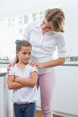 pic of argument  - Mother and daughter after an argument at home in kitchen - JPG